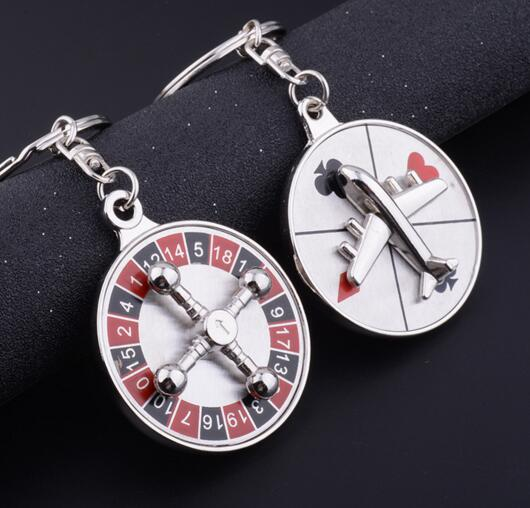 Creative Russian turntable key pendant can rotate the plane compass set keychain