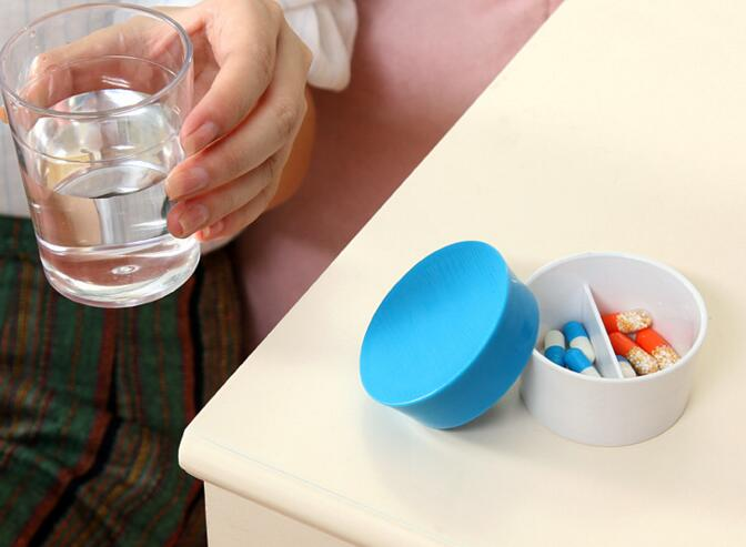 Portable cup shape two level pill box or pill organizer